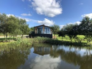 NEW ** EX DEMO **NOW SOLD ** Aspire Luxury Lodge with Decking sited on lake with sea views **NOW SOLD**